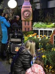 Vermont Flower Show attendees take in the flower display