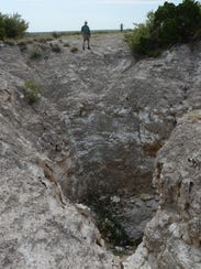A karst-formed sinkhole that funnels water into Eddy