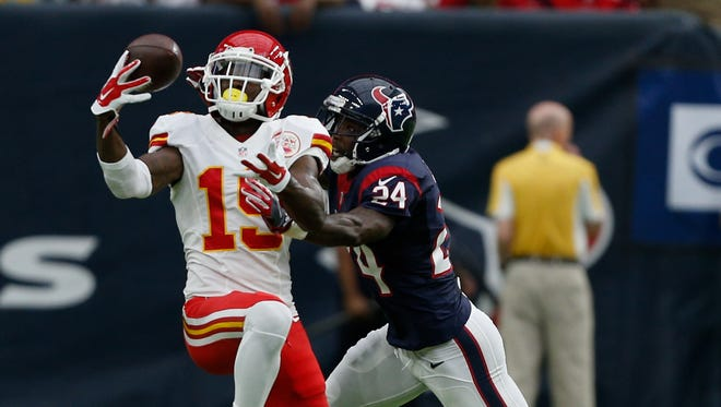 Jeremy Maclin #19 of the Kansas City Chiefs makes a catch as Johnathan Joseph #24 of the Houston Texans makes the tackle in the first half at NRG Stadium on September 18, 2016 in Houston, Texas.