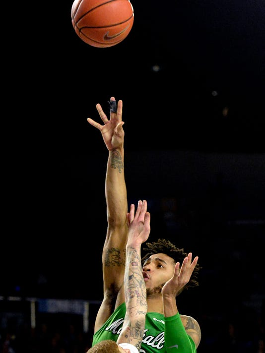 Marshall guard Rondale Watson (23) shoots over Middle Tennessee guard Tyrik Dixon, bottom, during the second half of an NCAA college basketball game, Saturday, March 3, 2018, in Murfreesboro, Tenn. Marshall won 76-67. (AP Photo/Mark Zaleski)