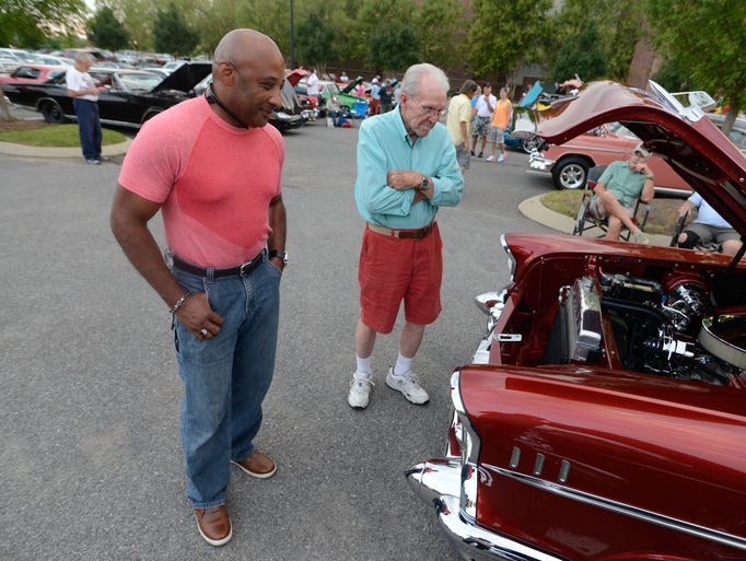 Tony Reeves and Jim Binkley check out classic cars during Cruisin' 4 A Cause Aug. 15 at the Streets of Indian Lake in Hendersonville. The event was a fundraiser for The Arc of Cumberland Valley.