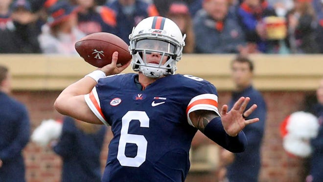 FILE - In this Sept. 2, 2017, file photo, Virginia quarterback Kurt Benkert (6) passes the ball during an NCAA college football game in Charlottesville, Va. Benkert ranks tied for second nationally in completions per game entering Virginia's game at Boise State on Friday night.  (Andrew Shurtleff/The Daily Progress via AP, File)