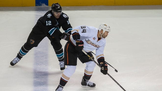 Anaheim Ducks right wing Daniel Winnik (34) skates with the puck as San Jose Sharks center Patrick Marleau (12) chases during the first period at SAP Center at San Jose.