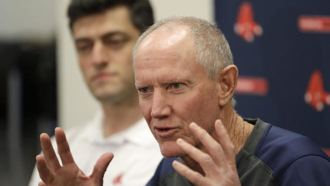 Ron Roenicke, right, and Chaim Bloom now have 11 open spots in their Summer Camp pool after signing Caleb Simpson on Saturday. (AP Photo/John Bazemore) ORG XMIT: FLJB111