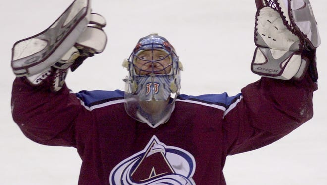 Patrick Roy goes from behind the bench to in front of the net to represent the Avalanche as the team's goalie in the alumni game Friday.