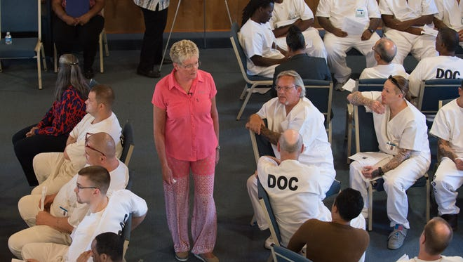 Kim Book speaks to inmates at the Sussex Correctional Institution to help them understand the impact of crime on victims.