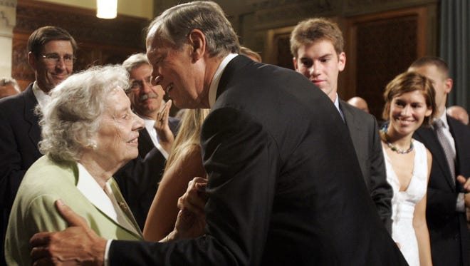 Former Gov. George Pataki kisses his mother, Peggy, at the Capitol in Albany in 2005, when he said he would not seek a fourth term.