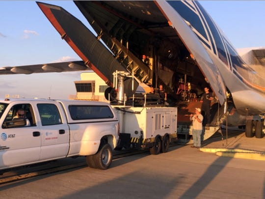 AT&T staff unload equipment to help repair Puerto Rico's
