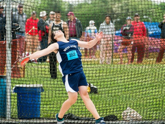 West York's Luke Hoffman competes in the discus throw