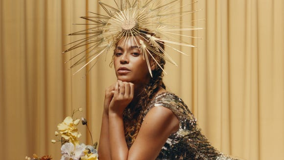 """Halo,"" for real: Beyonce paired a Philip Treacy fascinator"