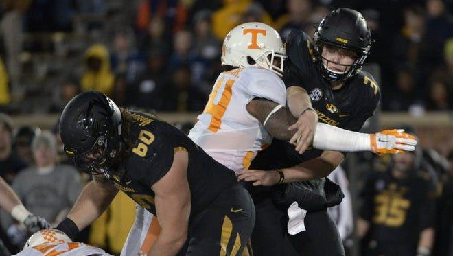 Missouri quarterback Drew Lock (3) is hit by Tennessee  linebacker Darrin Kirkland Jr. (34) on Nov. 21, 2015.