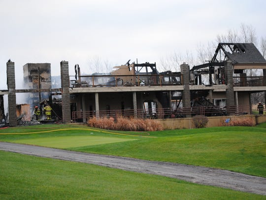 The remains of the Amana Colonies Golf Course, shortly after firefighters were finished extinguishing a blaze that destroyed the building Nov. 6, 2015. Amana Society officials have said the golf course will be reopening April 1, with a temporary building in its place.