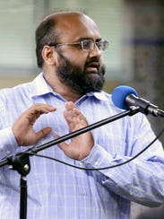 Asif Kunwal of New Castle speaks during a gathering