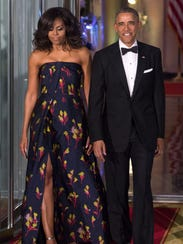 President Obama and first lady Michelle Obama await