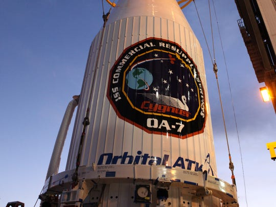 The Cygnus spacecraft, encapsulated in an extended payload fairing, is mated to the Atlas V booster at Cape Canaveral Air Force Station.
