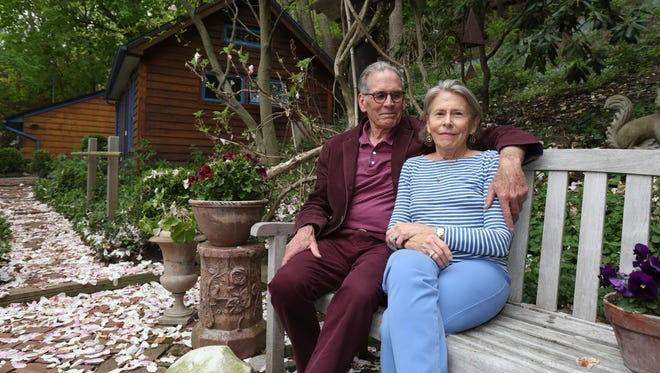 Homeowners Richard Dow, a psychotherapist, and Maggie Flanigan, an acting teacher, are pictured on the backyard patio of their home on River Road in Grand View-on-Hudson.