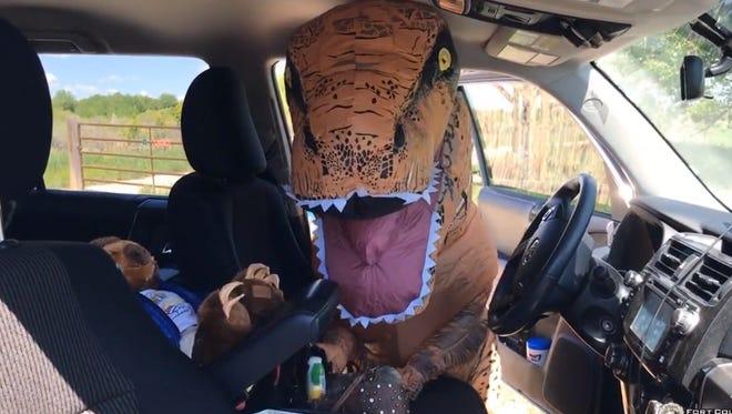 Dina the dinosaur breaks into an unlocked vehicle near Fort Collins.