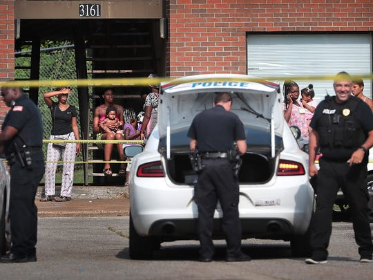 Memphis police investigate the scene where a 12-year-old