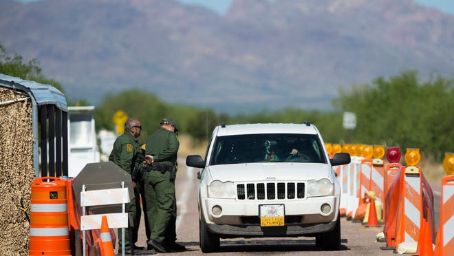 Border Patrol agents stop a car at a checkpoint on Arivaca Road, about 20 miles northeast of Arivaca.
