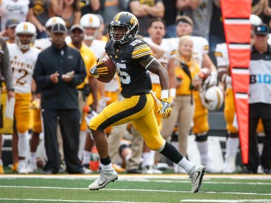 Iowa senior running back Akrum Wadley runs the ball against Wyoming at Kinnick Stadium in Iowa City on Saturday, Sept. 2, 2017.