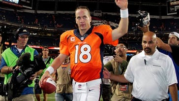 FILE - In this Sept. 5, 2013, file photo, Denver Broncos quarterback Peyton Manning (18) walks off the field after an NFL football game against the Baltimore Ravens, in Denver. Manning had the biggest day by an NFL QB in 44 years, throwing seven touchdown passes in directing Denver's 49-27 rout of the Baltimore Ravens, who had upset Denver in double overtime in the playoffs seven months earlier. (AP Photo/Joe Mahoney, File)