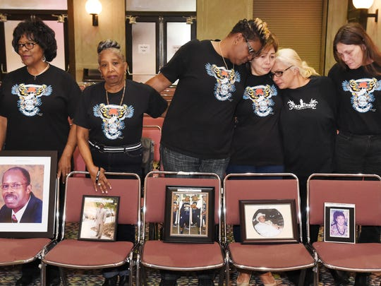 In this Feb. 10, 2017 file photo, family members of El Faro crew members stand with photographs of their loved ones during a break in a U.S. Coast Guard investigative hearing in Jacksonville, Fla.