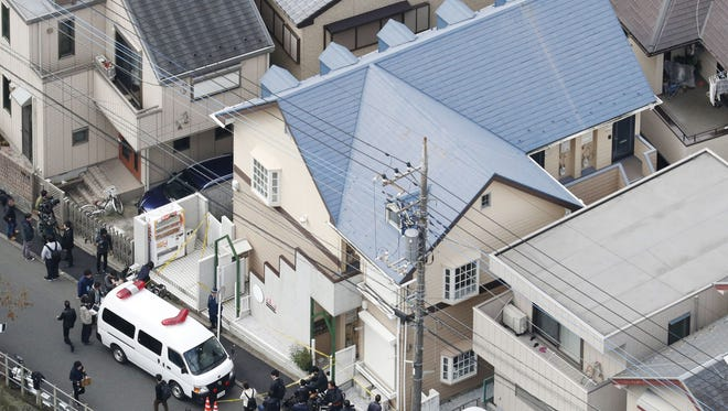 This aerial photo shows the apartment, center, where police found dismembered bodies in coolers in Zama city, southwest of Tokyo, on Oct. 31, 2017.