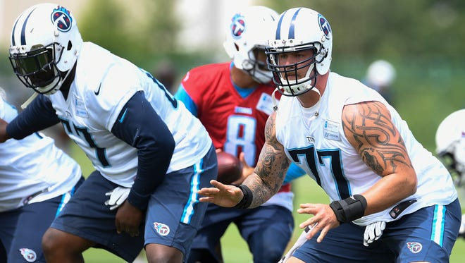 Titans tackle Taylor Lewan (77) prepares to make a block during OTA practices at Saint Thomas Sports Park Tuesday, May 23, 2017, in Nashville, Tenn.