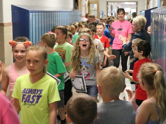 In May 2018, third grade students at R.C. Waters Elementary School in Oak Harbor parade through the halls for one last time before moving on to Oak Harbor Middle School.