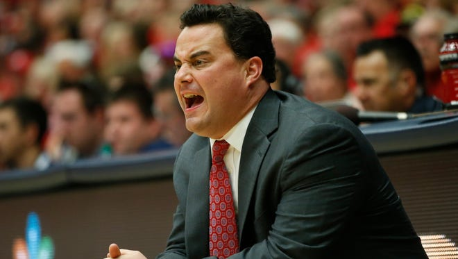 Fegb. 9, 2014 - Arizona head coach Sean Miller gives instructions to his team against Oregon State.