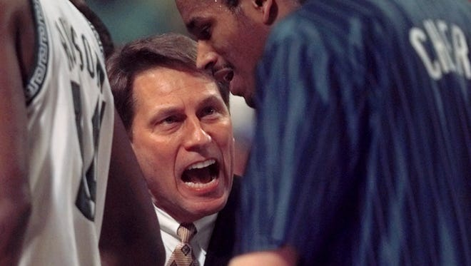 Michigan State coach Tom Izzo shouts at his players during a timeout in the first half against Kentucky in the NCAA Midwest Regional final in St. Louis on Sunday, March 21, 1999.