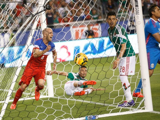 U.S.A midfielder Michael Bradley (left) celebrates a goal against Mexico during the first half at University of Phoenix Stadium in Glendale on April 2, 2014.