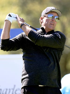 Phil Mickelson looks on his drive shot on the 18th hole during the first round of 2020 Dominion Energy Charity Classic at The Country Club of Virginia in Richmond, Va., Saturday, Oct. 17, 2020. (Daniel Sangjib Min/Richmond Times-Dispatch via AP)