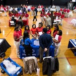 Pupils talk with business representatives as McKee Middle School and the Central Montgomery Optimist Club team up to host a career fair at the McKee campus in Montgomery, Ala. on Thursday January 28, 2016.