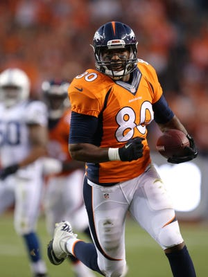 Denver Broncos Julius Thomas runs in for a touchdown for the Broncos in the first half.  The Indianapolis Colts play the Denver Broncos Sunday, September 7, 2014, evening at Sports Authority Field at Mile High in Denver CO.