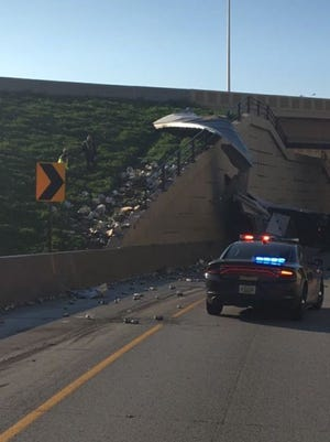 A semi-truck overturned Saturday morning on the Mitchell Interchange, temporarily closing the west-to-south ramp.