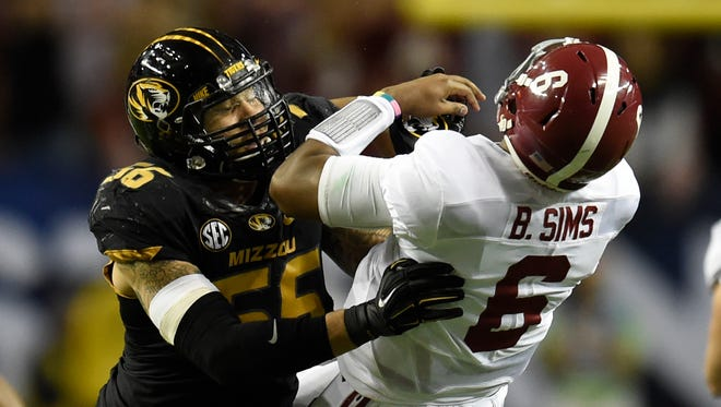 Missouri Tigers defensive lineman Shane Ray (56) tackles Alabama Crimson Tide quarterback Blake Sims (6) during the second quarter of the 2014 SEC Championship Game at the Georgia Dome.