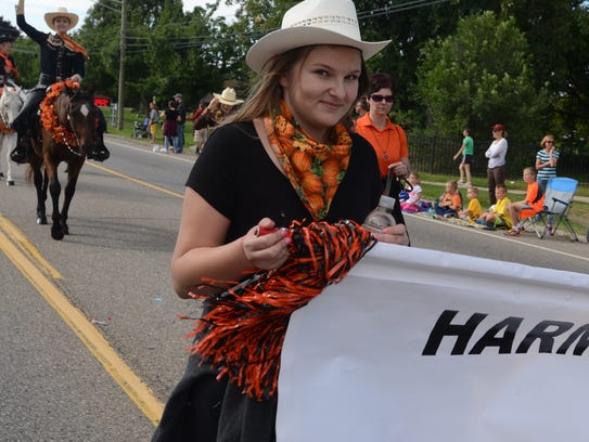 McKenna Rutherford marches along with Harmony Acres