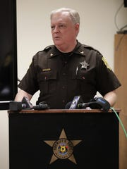Outagamie County Undersheriff Mike Jobe talks to members of the media Friday about the arrest of Vance D. Reed in a Sept. 14 double homicide in Oneida.