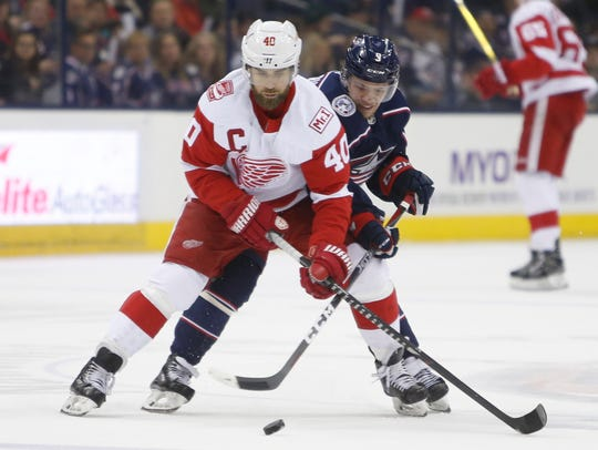 Detroit Red Wings' Henrik Zetterberg carries the puck