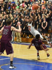Marlboro High School's Joe Nugent lays out for a layup against Southampton at Mount Saint Mary College on March 5 in a Class B regional boys basketball final.