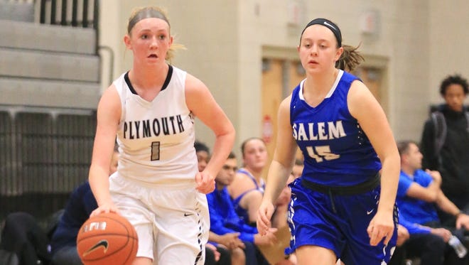 Dribbling up the court Friday for Plymouth is freshman Elle McCaslin (No. 1). Closing in on defense for Salem is Jenna Sydlowski (No. 15).