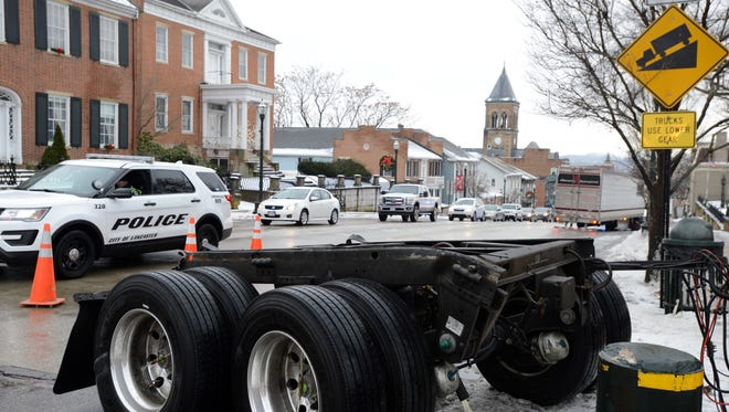 The back axels of a semi trailer sit at the corner of North High Street and East Main Street Monday, Jan. 8, 2018, in Lancaster.