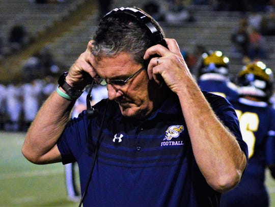 Stephenville coach Greg Winder speaks to assistand