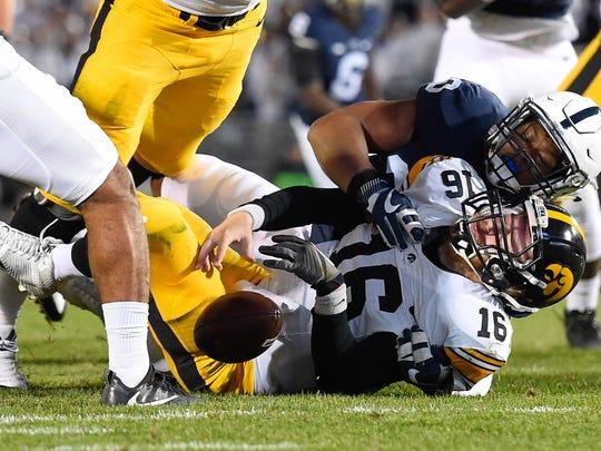 Iowa quarterback C.J. Beathard briefly lost his grip