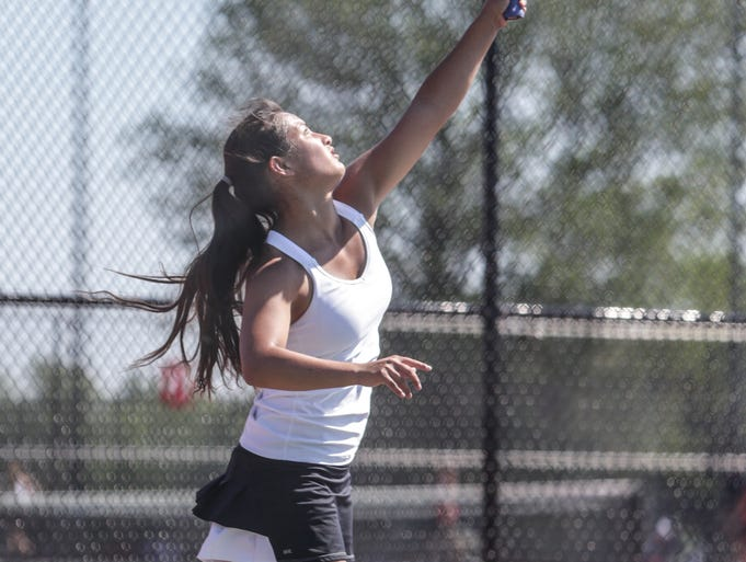 Saturday May 31st, 2014, Jade Kawamoto (shown here), from Greenwood, plays Hannah Rudolph from Terre Haute in the girls tennis semistate, at Center Grove High School.