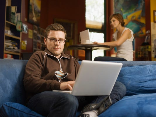 Hipster man working on laptop computer