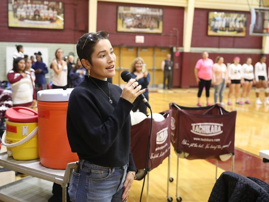 Bianca Muniz, 23, from Sleepy Hollow, sings the National Anthem during a cancer fundraiser for her during a home volleyball game at Ossining high school, Oct. 17, 2017. Bianca is an ovarian cancer survivor who is currently battling breast cancer.