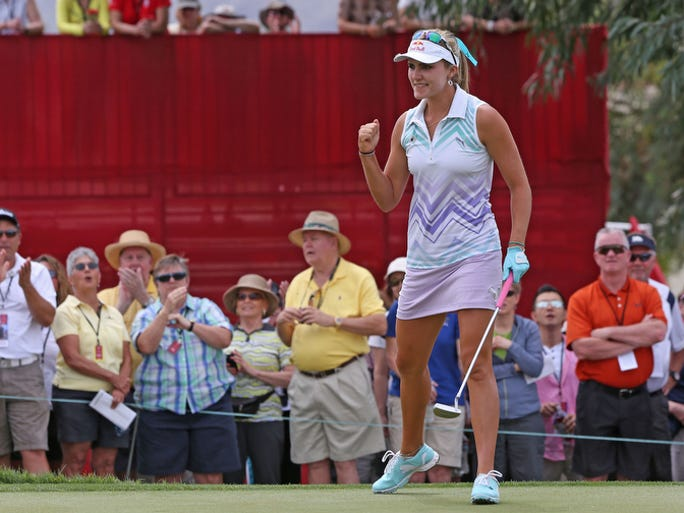 Lexi Thompson celebrates a birdie putt on her final hole of the day Friday at the Kraft Nabisco Championship in Rancho Mirage, April 4, 2014.