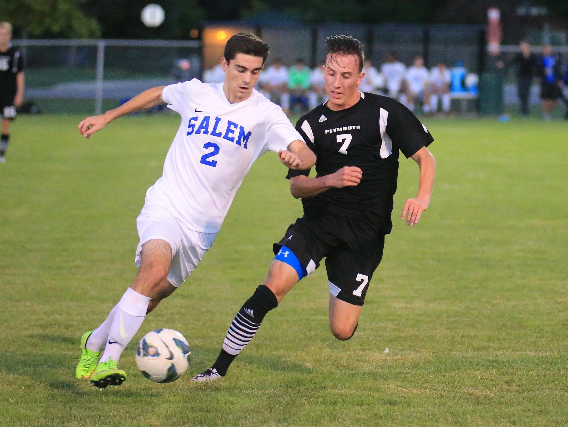 It's a footrace between Salem's Austin Siterlet (No. 2) and Plymouth's Mike Blake (No. 7).